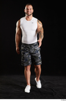 Grigory  1 camo shorts front view sports walking white sneakers white tank top whole body 0002.jpg